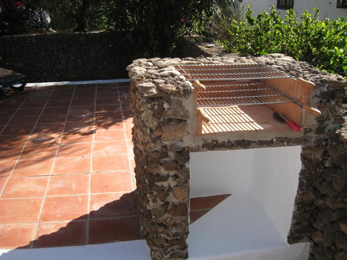 24) BBQ on patio built in local stone
